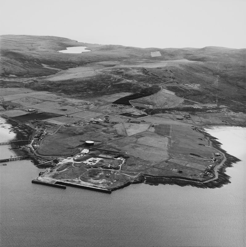 Hoy, Lyness, oblique aerial view, taken from the ENE, centred on the Royal Navy Oil Terminal. Visible in the top half of the photograph is Wee Fea Naval Signal Station.