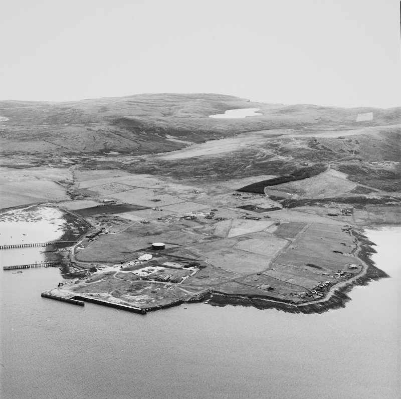 Hoy, Lyness, oblique aerial view, taken from the NE, centred on the Royal Navy Oil Terminal. Visible in the centre right of the photograph is Wee Fea Naval Signal Station.
