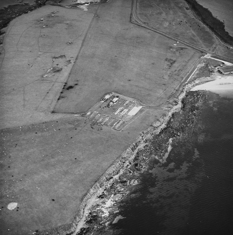 Oblique aerial view, taken from the NE, centred on The Italian Chapel, and adjacent Military Camp.