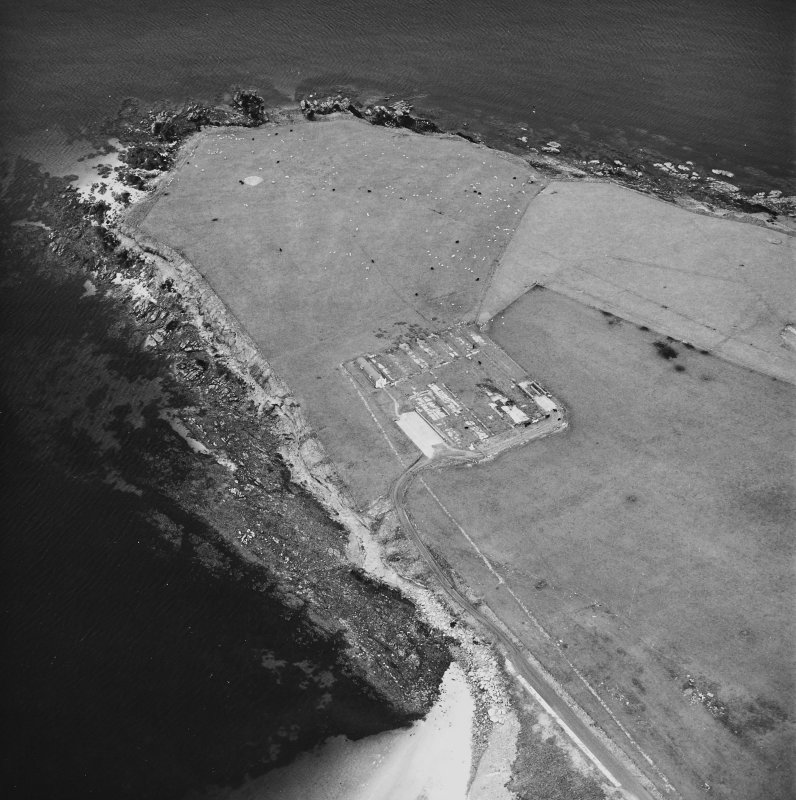 Oblique aerial view, taken from the WNW, centred on The Italian Chapel, and adjacent Military Camp.