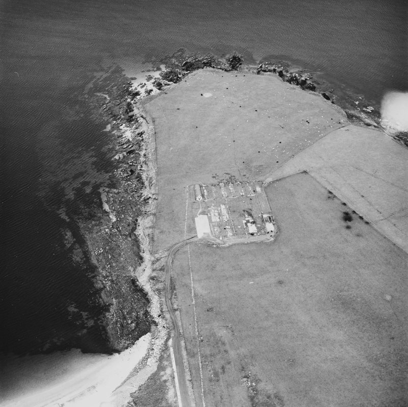 Oblique aerial view, taken from the WSW, centred on The Italian Chapel, and adjacent Military Camp.