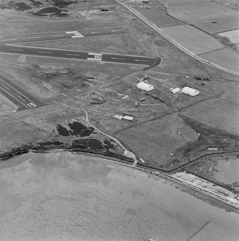 Oblique aerial view from N.  Visible are two Mainhill type hangars, a hangar base and two protected dispersal bays.