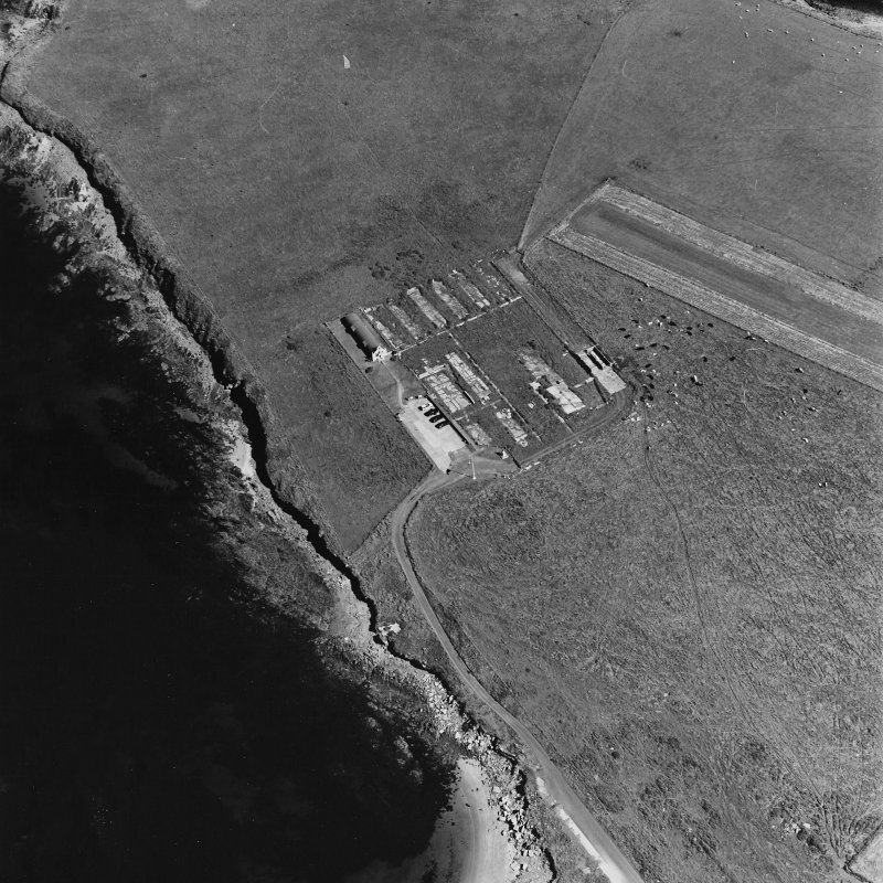 Oblique aerial view of Orkney, Lamb Holm, Italian Chapel and the remains of the prisoner-of-war camp, from W.
