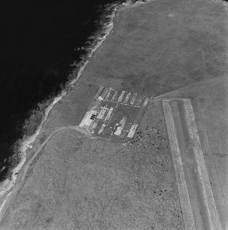 Oblique aerial view of Orkney, Lamb Holm, Italian Chapel and the remains of the prisoner-of-war camp, from WSW.