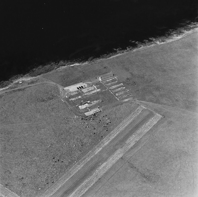 Oblique aerial view of Orkney, Lamb Holm, Italian Chapel and the remains of the prisoner-of-war camp, from SW.