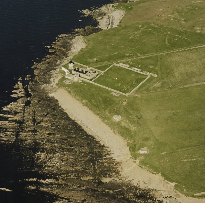 Oblique aerial view of Orkney, Graemsay, Hoy Sound Lighthouse and Graemsay coast battery, taken from the SW.