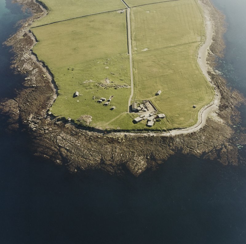 Oblique aerial view of Orkney, Car Ness, Car Ness and Wellington Batteries, from NE.  Visible are the gun-emplacements, battery observation towers, searchlight platforms and Nissen huts for both batteries. The site of a heavy anti-aircraft battery is just discernable to the S.