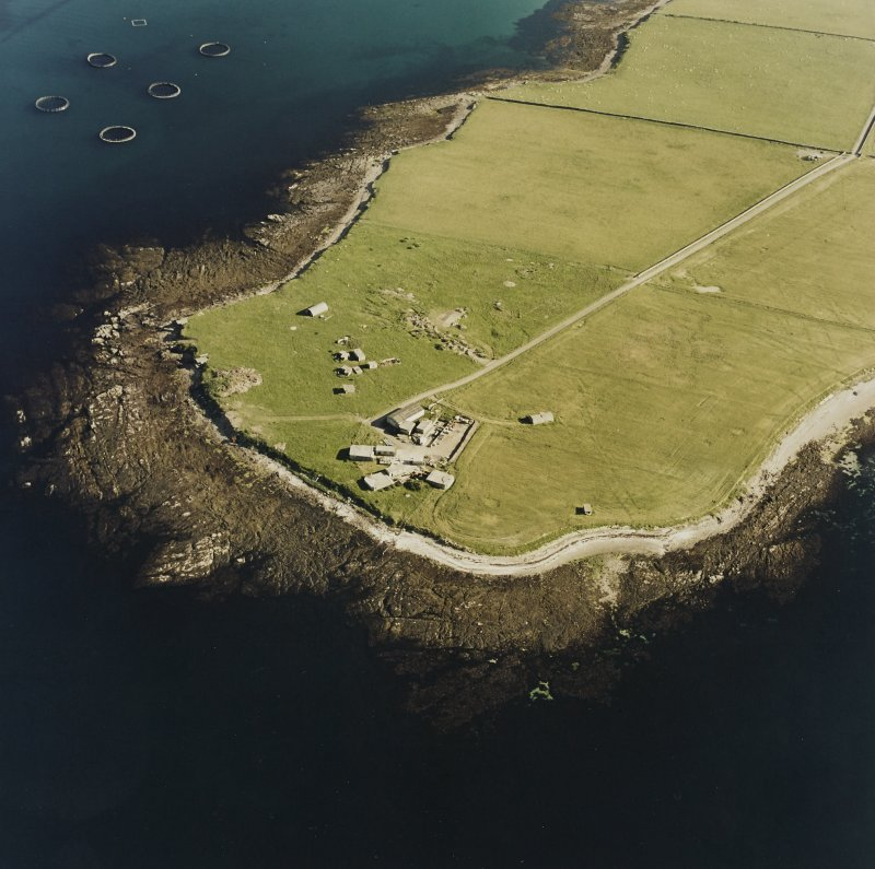 Oblique aerial view of Orkney, Car Ness, Car Ness and Wellington Batteries, from N.  Visible are the gun-emplacements, battery observation towers, searchlight platforms and Nissen huts for both batteries. The site of a heavy anti-aircraft battery is just discernable to the S.