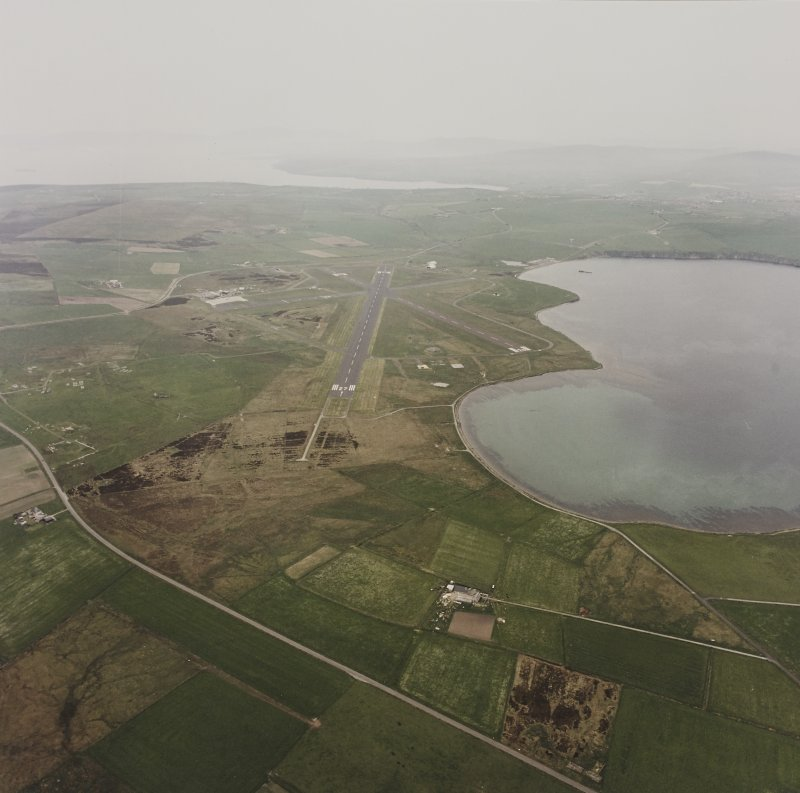 Oblique aerial view from NE.  Also visible are the hut bases of the military accommodation camp at Longtownmail