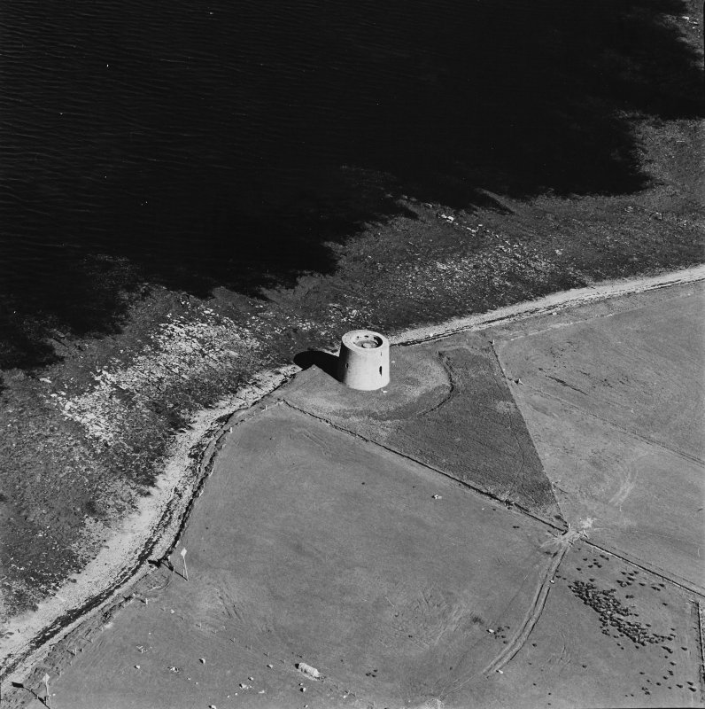 Oblique aerial view centred on Martello tower from NW.