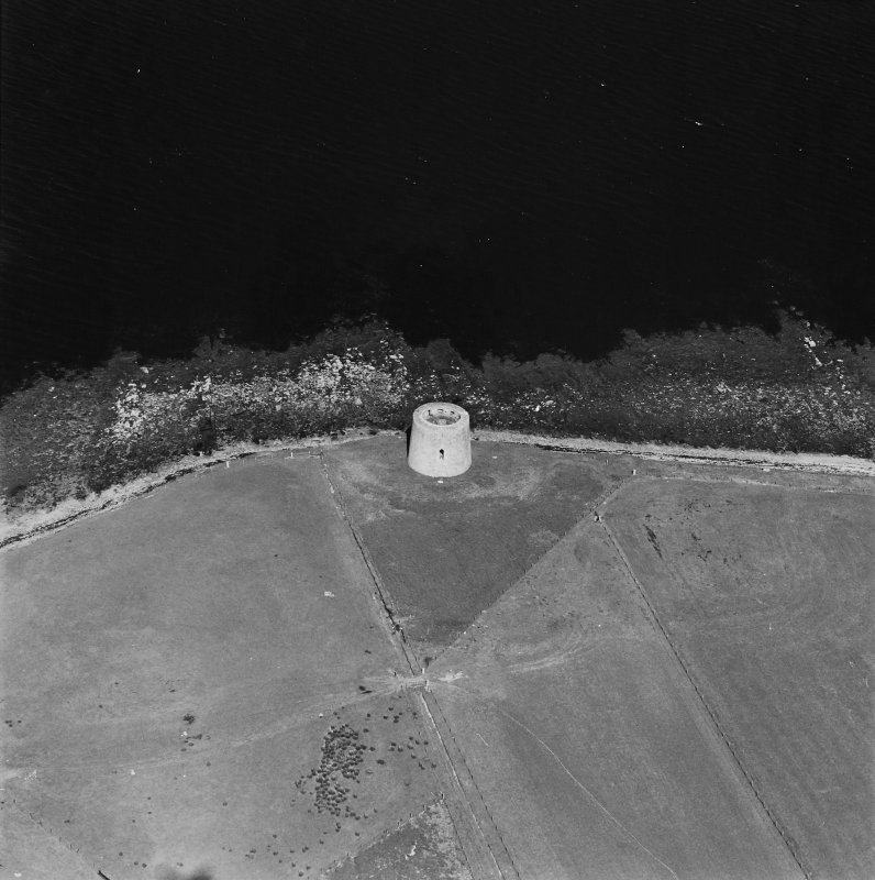 Oblique aerial view centred on Martello tower from W.