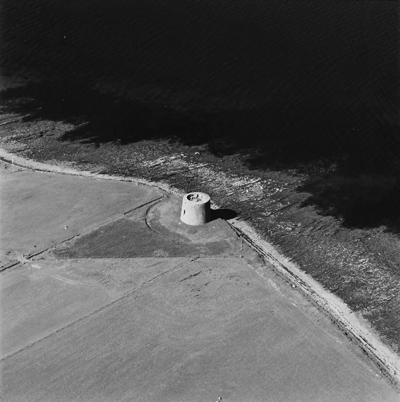 Oblique aerial view centred on Martello tower from SW.