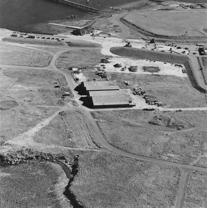 Oblique aerial view of Orkney, Hoy, Lyness, Royal Naval Oil terminal, of part of the RN base and the Scapa Flow Museum, formerly the main boiler house.