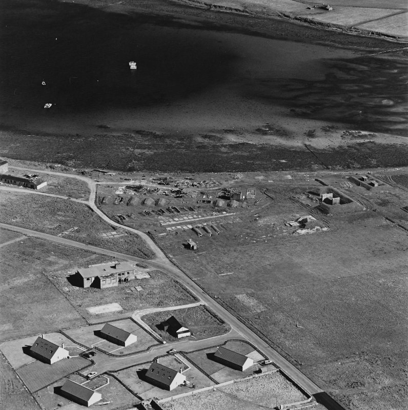 Oblique aerial view of Orkney, Hoy, Lyness, Royal Naval Oil terminal, the NAAFI building, generating house and a series of air raid shelters.