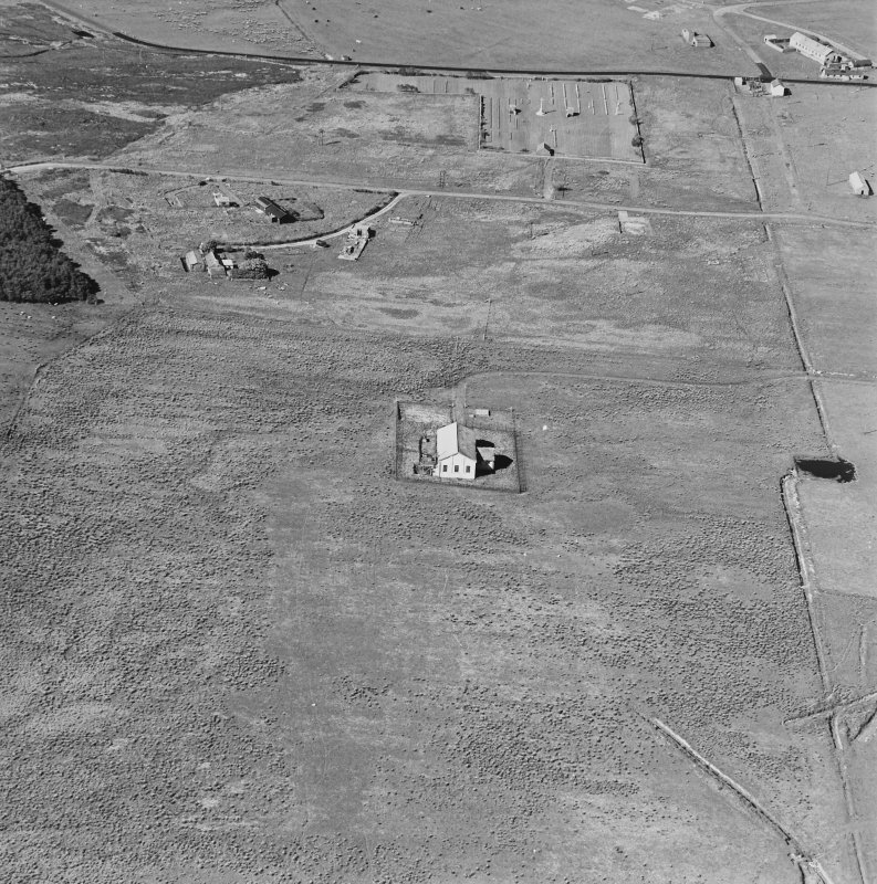 Oblique aerial view of Orkney, Hoy, Lyness, Royal Naval Oil terminal, view from SSW, of the Pumphouse for the underground oil tanks.  The Naval Cemetery is visible in the background.