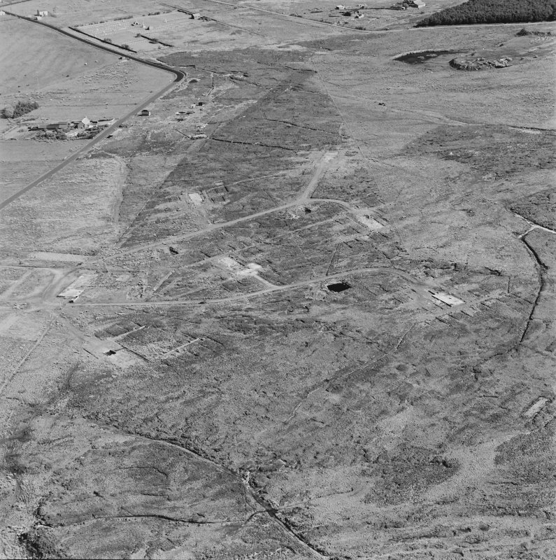 Oblique aerial view of Orkney, Hoy, Lyness, Royal Naval Oil Terminal, view from NW of the hut bases of a military camp to the NW of the Naval Base.  In the background the officers' quarters and the Naval Cemetery.