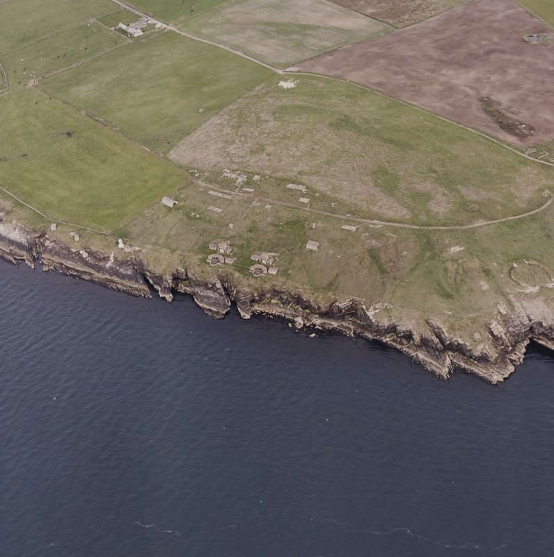 Oblique aerial view, taken from the NW, centred on Balfour Battery, and showing the edge of Hoxa Battery in the centre right of the photograph.