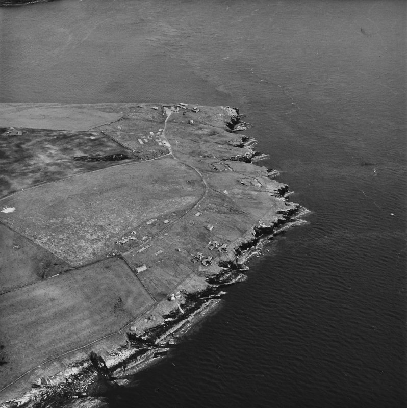 Oblique aerial view, taken from the N, centred on Balfour Battery and Hoxa Battery.