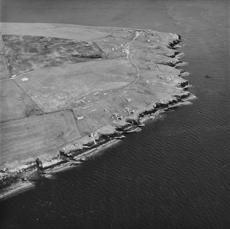 Oblique aerial view, taken from the NNW, centred on Balfour Battery, and showing Hoxa Battery in the background.