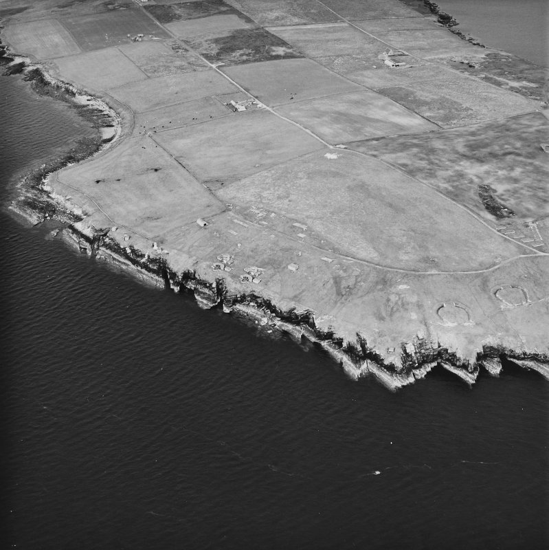 Oblique aerial view, taken from the W, centred on Balfour Battery, and showing Hoxa Battery in the left centre of the photograph.