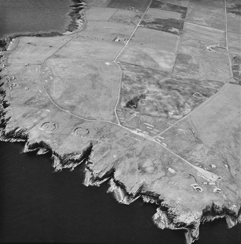 Oblique aerial view, taken from the SW, centred on Hoxa Batteries and Camp Site, and showing Balfour Battery in the top left-hand corner area of the photograph.