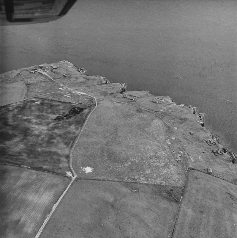 Oblique aerial view, taken from the NE, showing Hoxa Batteries and Camp Site in the centre and left half, and Balfour Battery in the centre right of the photograph.