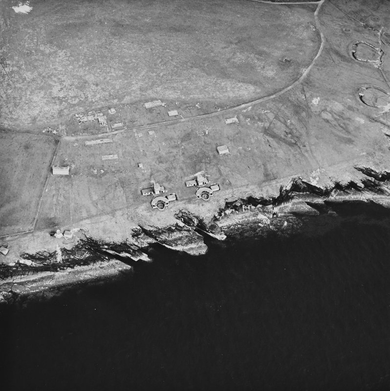 Oblique aerial view, taken from the NW, centred on Balfour Battery, and showing Hoxa Battery in the top right-hand corner of the photograph.