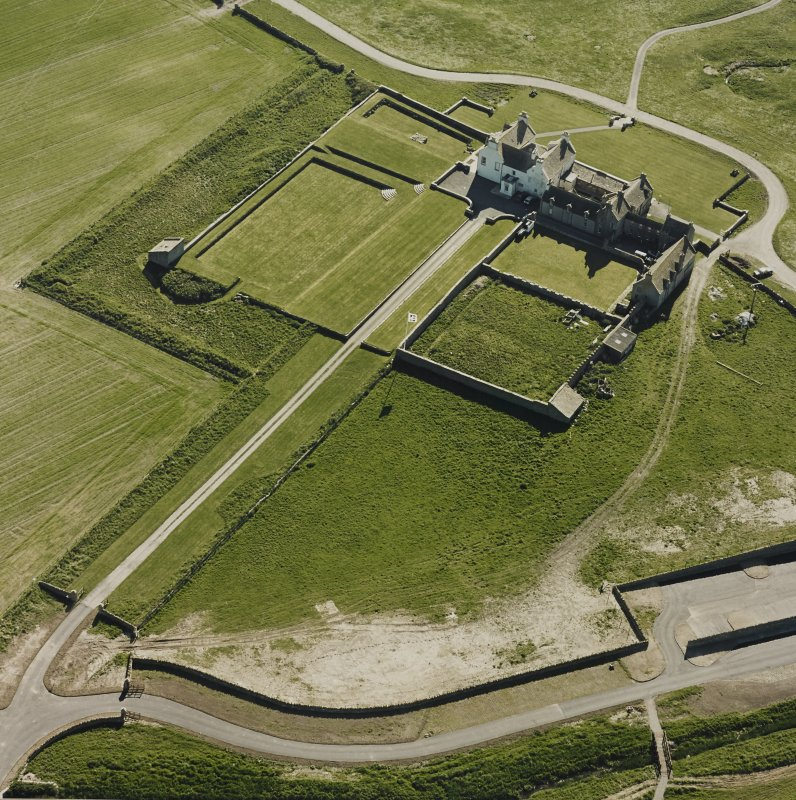Aerial view of Orkney, Bay of Skaill, Skaill House, gardens, and dovecot, taken from the ESE.