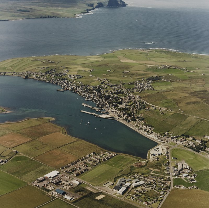 Aerial view of Stromness town and harbour, taken from the NE.  Visible in the background is the Island of Hoy