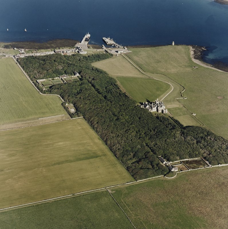 Oblique aerial view of Orkney, Shapinsay, Balfour Castle and walled garden, Balfour village, harbour with the Dishan Tower dovecot, taken from the WNW.