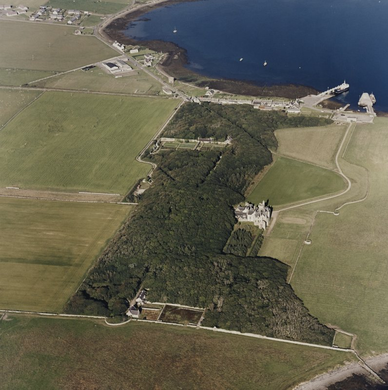 Oblique aerial view of Orkney, Shapinsay, Balfour Castle and walled garden, Balfour village and harbour, taken from the W.