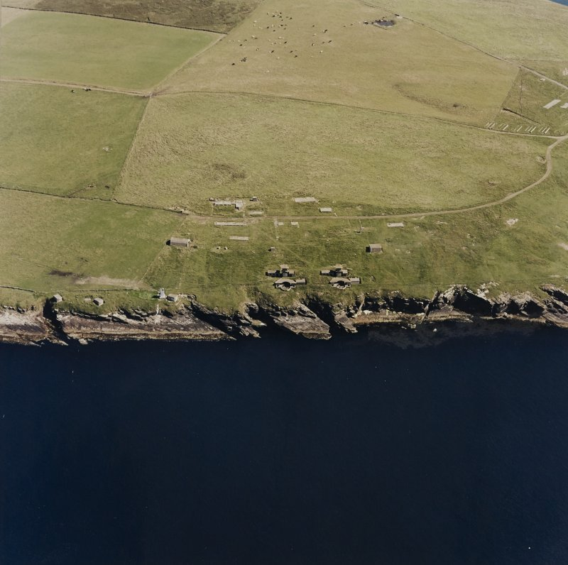 Oblique aerial view of Orkney, South Ronaldsay, Hoxa Head, Balfour Battery and lighthouse, taken from the WSW.