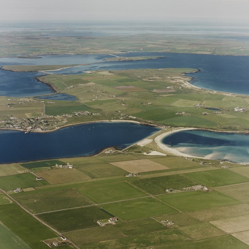 Oblique aerial view of Orkney, Burray, general view taken from the S of Burray, Burray village and all four Churchill Barriers.
