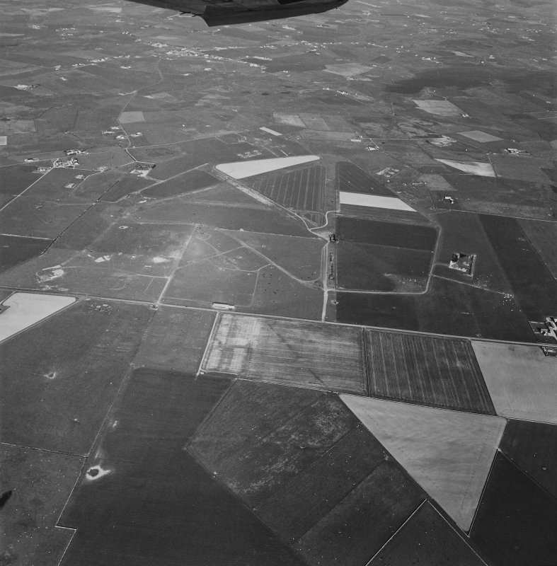 Aerial view of Orkney, Sandwick, taken from the W, Skeabrae airfield, runways, perimeter track and bomb store.