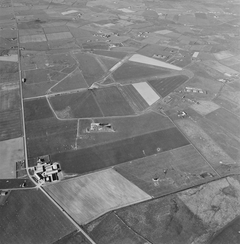 Aerial view of Orkney, Sandwick, taken from the S, Skeabrae airfield, runways, perimeter track and bomb store.