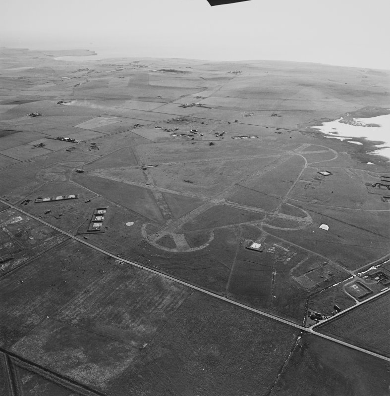 Aerial view of Orkney, Isbister, taken from the NE, Twatt airfield, runways, perimeter track, aircraft hangar bases, dispersal bays and bomb store.