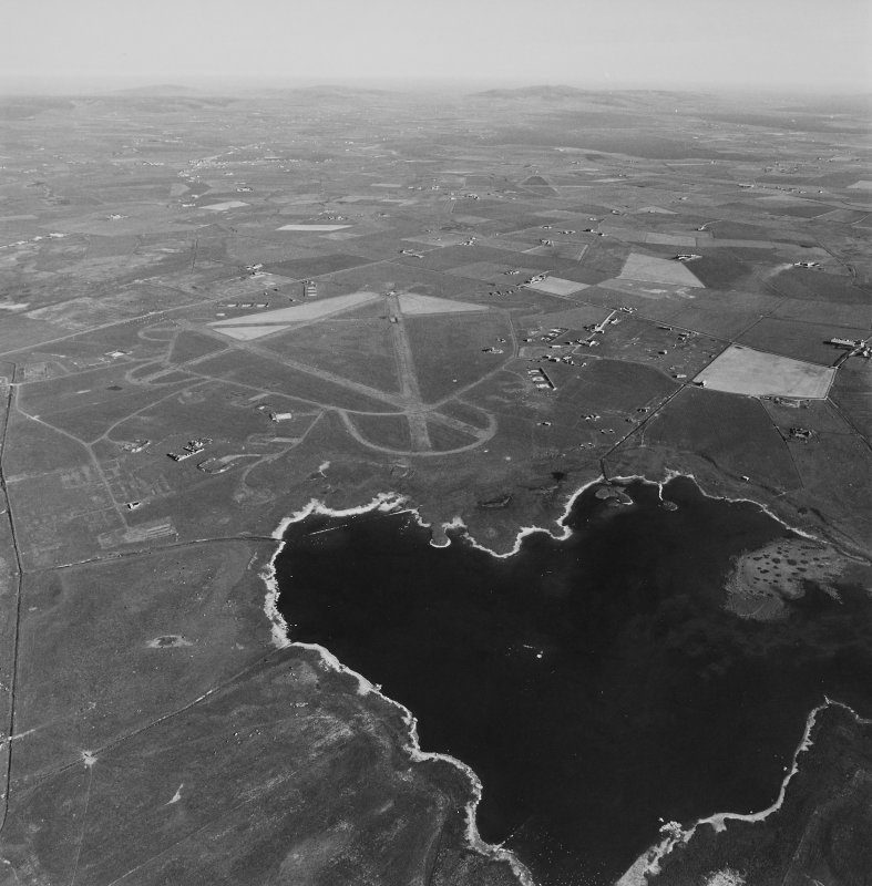 Aerial view of Orkney, Isbister, taken from the NW, Twatt airfield, runways, technical/recreation area, perimeter track, aircraft hangar bases, dispersal bays and bomb store.