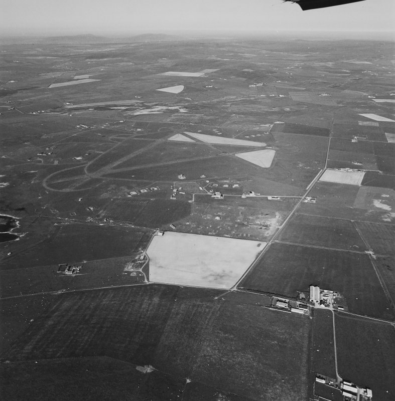 Aerial view of Orkney, Isbister, taken from the N, Twatt airfield, runways, technical/recreation area, perimeter track, aircraft hangar bases, dispersal bays and bomb store.