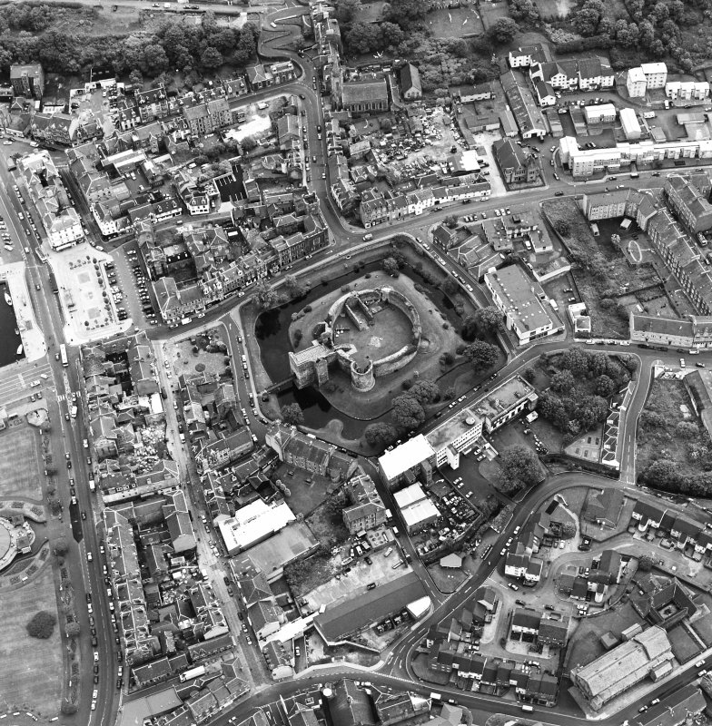 Oblique aerial view of Rothesay, taken from the NW, centred on a castle.  The photograph gives a general view of the town.