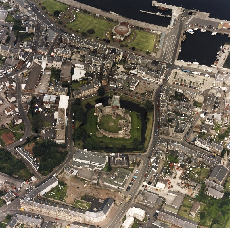 Oblique aerial view of Rothesay centred on the remains of the castle and chapel, taken from the S.