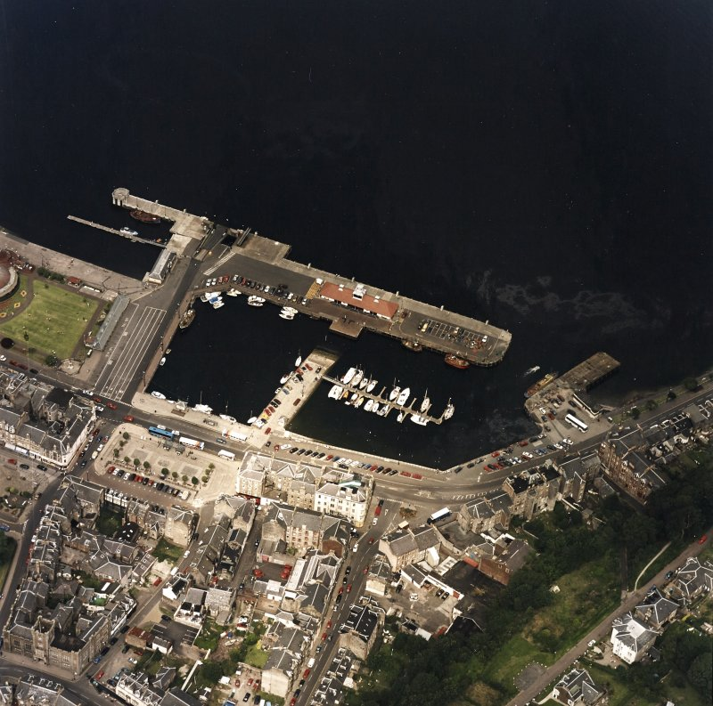 Oblique aerial view centred on the harbour, taken from the SSE.