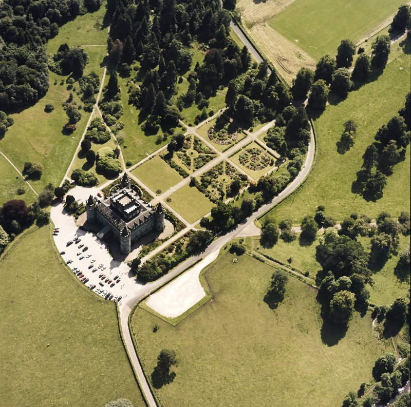 Oblique aerial view centred on the country house and garden, taken from the N.
