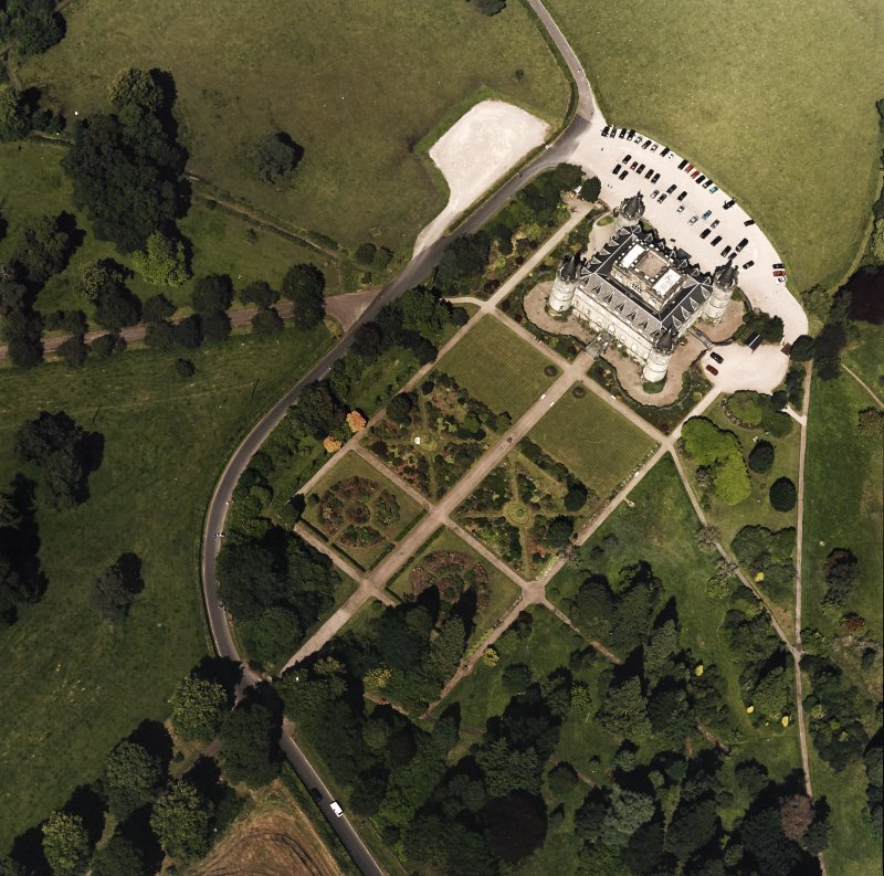 Oblique aerial view centred on the country house and garden, taken from the S.