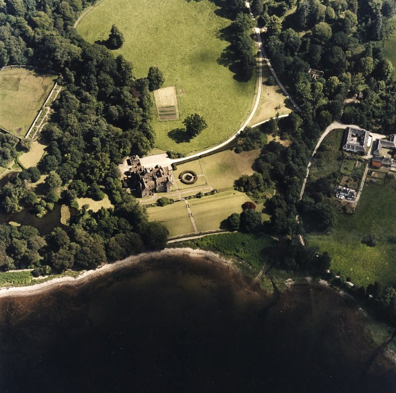 Oblique aerial view centred on Ardkinglas House with the steading and remains of the old house adjacent, taken from the NW.