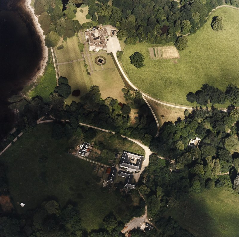 Oblique aerial view centred on Ardkinglas House with the steading and remains of the old house adjacent, taken from the SW.