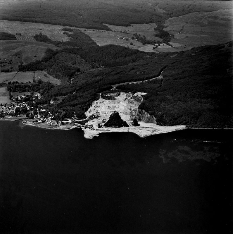 Oblique aerial view centred on the quarry and pier, taken from the SE.