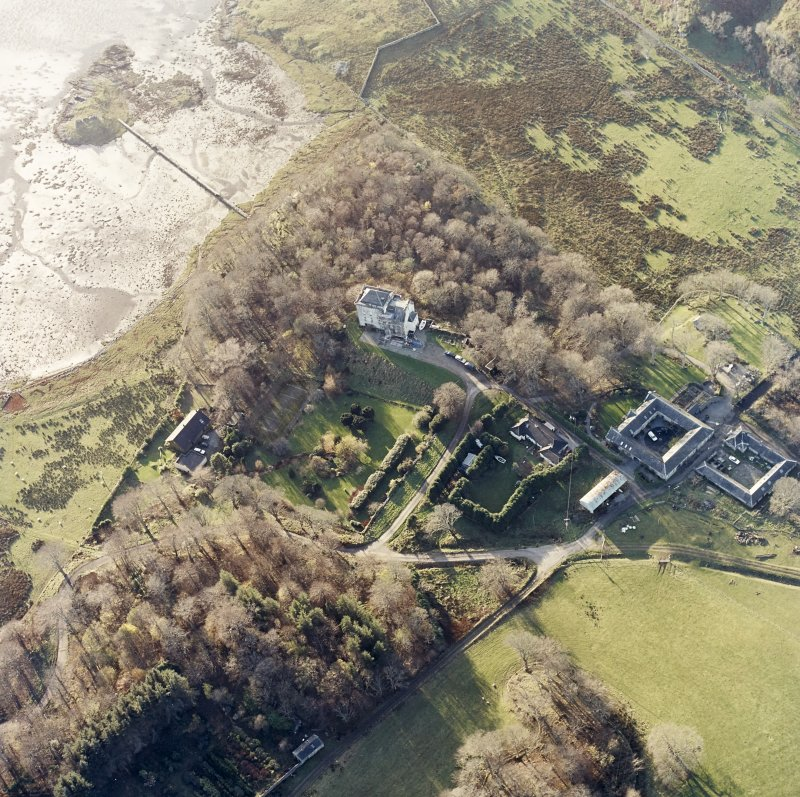 Oblique aerial view centred on the castle and the farmstead, taken from the ENE.