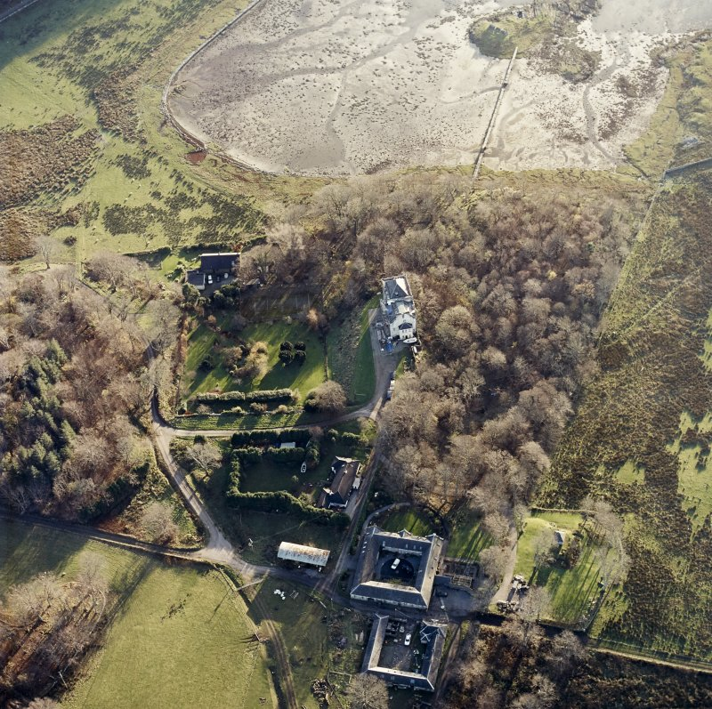 Oblique aerial view centred on the castle and the farmstead, taken from the NNE.