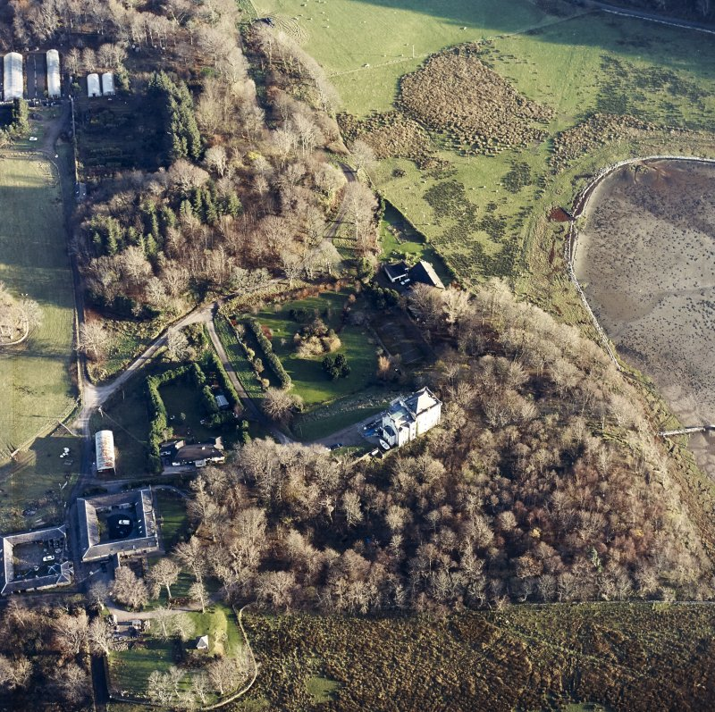 Oblique aerial view centred on the castle and the farmstead, taken from the WNW.