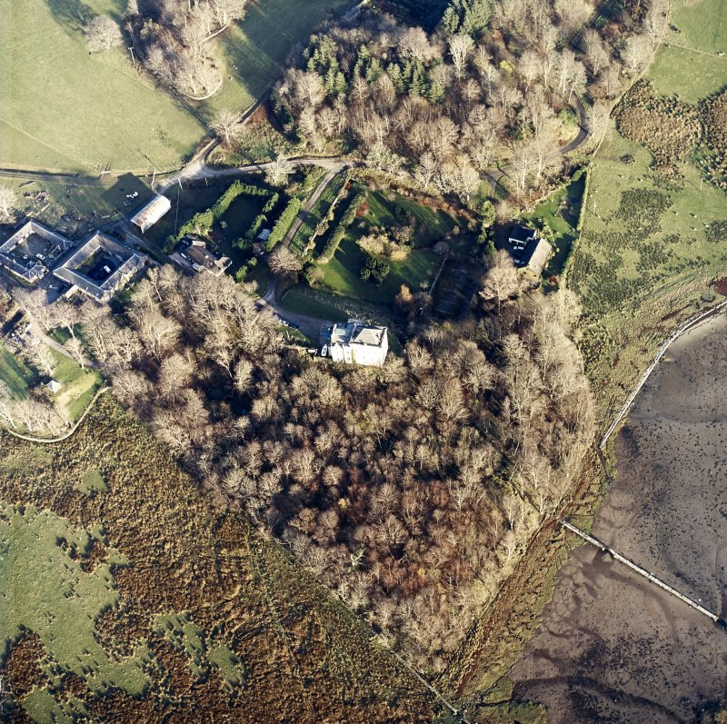 Oblique aerial view centred on the castle and the farmstead, taken from the WSW.